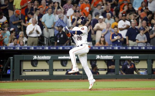 Houston Astros' Robinson Chirinos celebrates after hitting a home run against the Detroit Tigers during the seventh inning of a baseball game Wednesday, Aug. 21, 2019, in Houston.