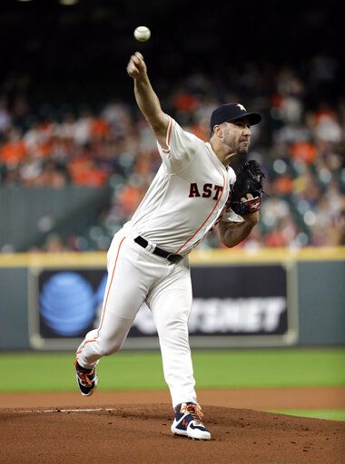 Houston Astros starting pitcher Justin Verlander throws against the Detroit Tigers during the first inning of a baseball game Wednesday, Aug. 21, 2019, in Houston.