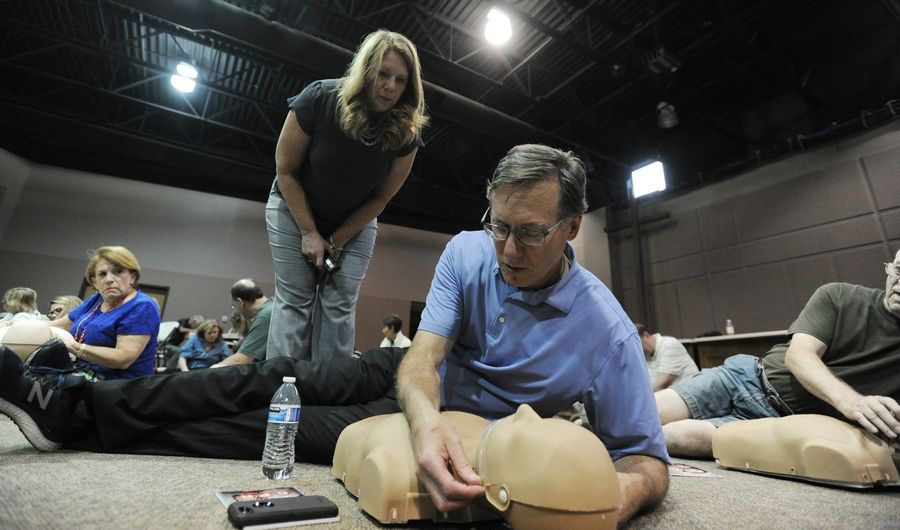 Wendy Murphy, basic life support coordinator for Edward-Elmhurst Health, teaches Rudi Tanck of Naperville the correct procedures for administering CPR. Tanck himself received CPR after he suffered a heart attack, and now he's learning the technique -- and encouraging others to get trained -- so more bystanders can be prepared to respond.