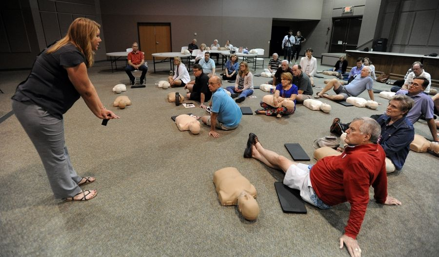 Wendy Murphy, basic life support coordinator for Edward-Elmhurst Health, teaches members of Knox Presbyterian Church in Naperville the correct way to administer chest compressions while giving CPR. The church is hosting at least five CPR training courses after the technique helped save the life of congregation member Rudi Tanck after he suffered a heart attack.