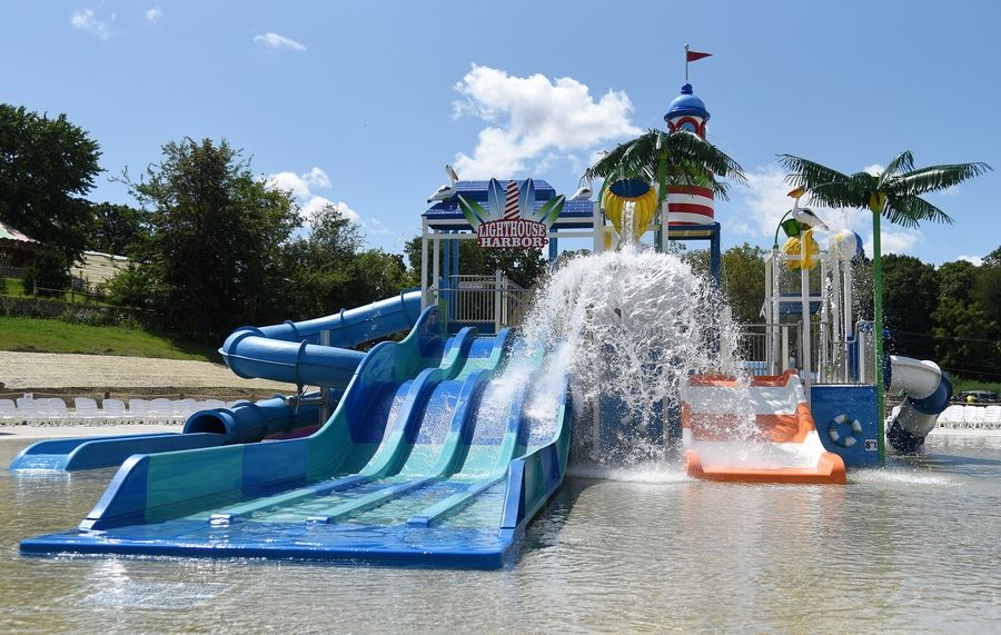 Santa Springs, an interactive water play attraction within the Santa's Village amusement park in East Dundee, opens Saturday. Santa's Village's largest expansion in its 60-year history features zero-depth entry to a 10,000-square-foot, 8-inch deep wading pool with a two-story interactive water play structure.