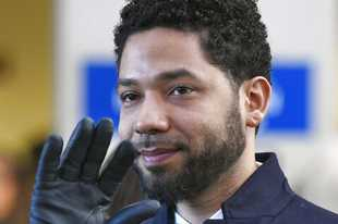 FILE - In this March 26, 2019, file photo, actor Jussie Smollett smiles and waves to supporters before leaving Cook County Court after his charges were dropped in Chicago. An Illinois judge seems close to appointing a special prosecutor to look into why state prosecutors abruptly dropped charges against Smollett accusing him of staging a racist, anti-gay attack against himself. A hearing Friday, Aug. 23 will be one of the first opportunities for Judge Michael Toomin to name someone since his surprise ruling in June that a special prosecutor was warranted. Among the options available to a special prosecutor would be to restore charges against Smollett. (AP Photo/Paul Beaty, File)