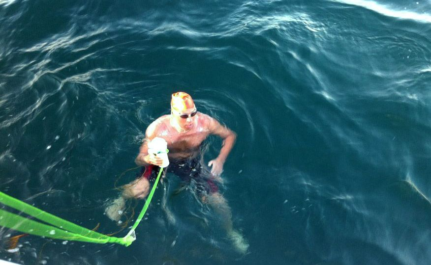 Barrington resident Doug McConnell is prepared to navigate through strong currents and possibly sharks for what could be the first Atlantic Ocean swim on a specific route between Nantucket and Martha's Vineyard to raise money to help ALS patients. Here, he stopped to eat during an English Channel swim in 2011.
