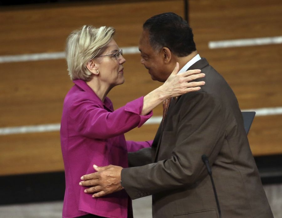 Democratic presidential candidate Sen. Elizabeth Warren embraces Rev. Jesse Jackson after being introduced at the Rainbow PUSH Coalition International Convention in Chicago in June.