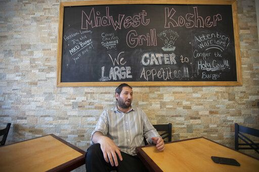 Aryeh Kramer talks about the growing Orthodox Jewish Community in South Bend at the Midwest Kosher Deli. (Santiago Flores/South Bend Tribune via AP)
