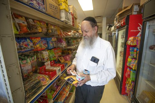 Rabbi Simsha Smolenksi does a little shopping at the Midwest Kosher Deli. (Santiago Flores/South Bend Tribune via AP)