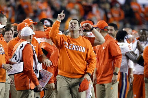 FILE - In this Jan. 7, 2019, file photo, Clemson head coach Dabo Swinney celebrates in the final seconds of the NCAA college football playoff championship game against Alabama, in Santa Clara, Calif. For the first time, the defending national champion Tigers are No. 1 in The Associated Press preseason Top 25 presented by Regions Bank, Monday, Aug. 19, 2019.
