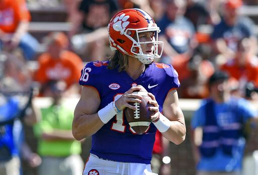 FILE - In this April 6, 2019, file photo, Clemson's Trevor Lawrence drops back to pass during Clemson's annual Orange and White NCAA college football spring scrimmage in Clemson, S.C. After leading Clemson to a national championship as a freshman, Lawrence was selected an AP preseason All-American by poll voters.