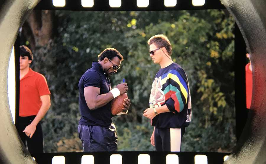 The Daily Herald Archives, Assignment 89,960-A, Gilbert Boucher photo: Chicago Bears Walter Payton and Jim McMahon sing a football as the team gathered in Lake Forest for the end of the National Football League Players Association strike in November of 1987.