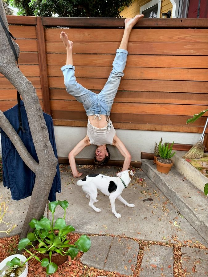 The Jordan Family Foundation wants to show support for the Swifty Foundation's endeavor to make September Childhood Cancer Awareness Month. Pictured is Steffan Argus and the family dog Cedar, to bring awareness to Childhood Cancer Awareness. They challenge everyone to do a handstand to show their support.