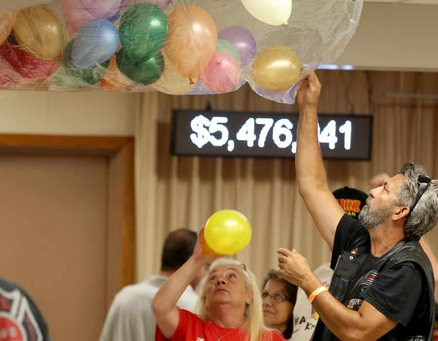 Mark Oakley of Wauconda helps volunteers load a balloon drop before the conclusion of the Queen of Hearts drawing at McHenry VFW Post 4600 Tuesday.