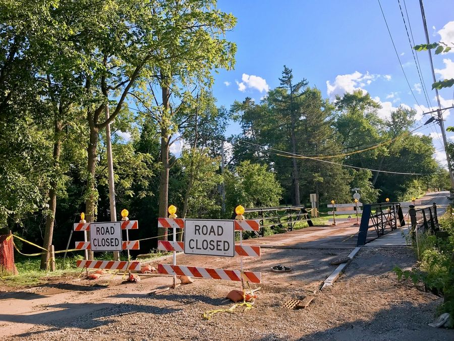 Downtown Long Grove's historic bridge is closed again to accommodate Robert Parker Coffin Road construction. The Long Grove village board Tuesday night hired a company to install a replacement timber cover.