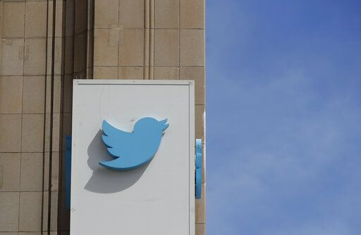 FILE - This July 9, 2019, file photo shows a sign outside of the Twitter office building in San Francisco. Social media platforms are facing intense, often contradictory demands from Washington to oversee internet content without infringing on First Amendment rights.
