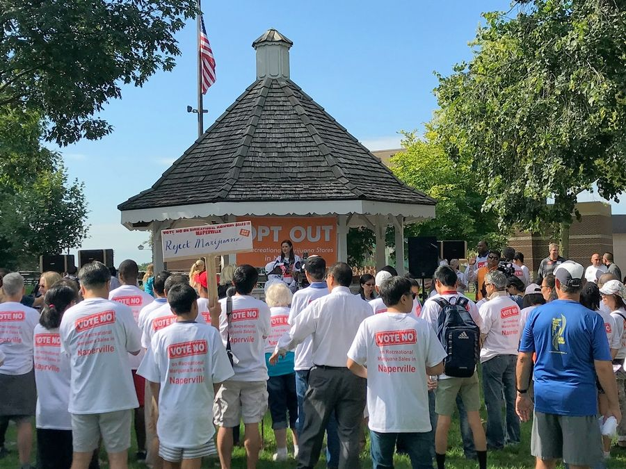 "Close to 200 Naperville residents attended an anti-marijuana rally Saturday morning in Central Park to urge city officials to ""opt out"" of allowing legalized marijuana sales."