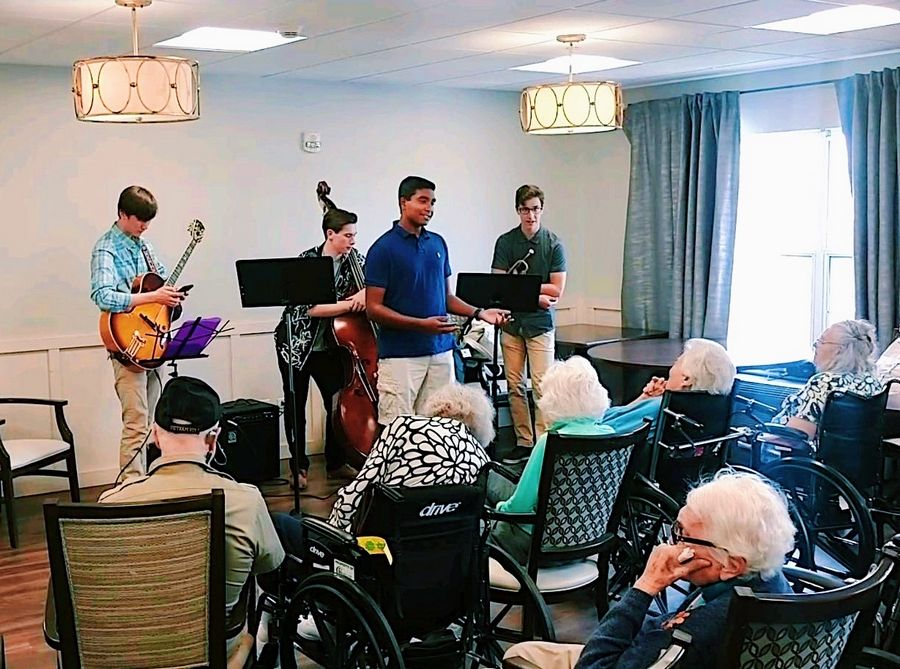 Stevenson senior Kiran Mohan introduces the music therapy concept and the team to memory care residents at Belmont Village in Buffalo Grove.