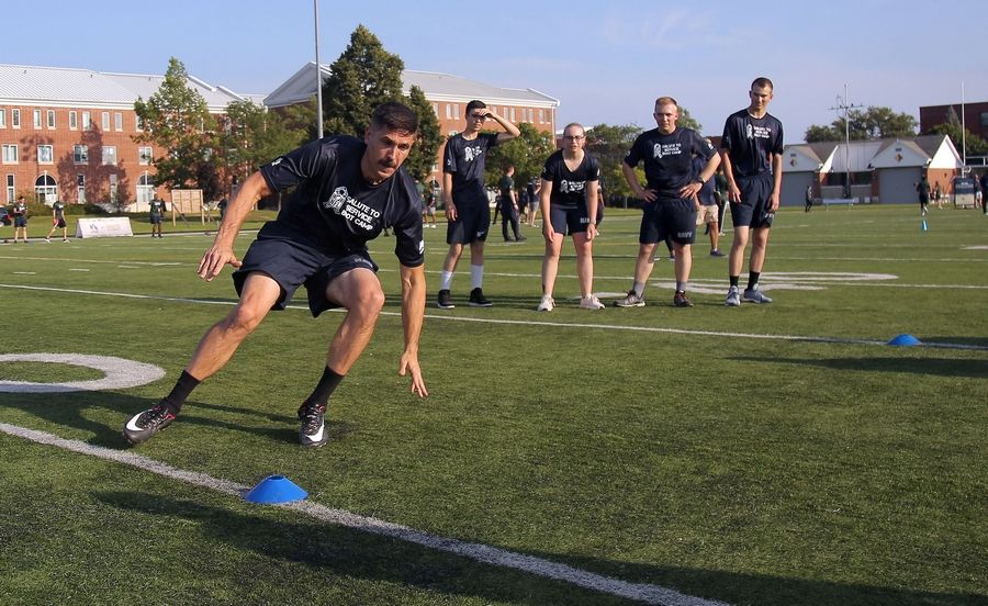 Chief Matthew Vine goes through a shuttle drill as Great Lakes Naval Station military service members trained with NFL stars Brian Urlacher and Jordy Nelson in the USAA's Salute to Service NFL Boot Camp Tuesday at Great Lakes Naval Station in North Chicago.