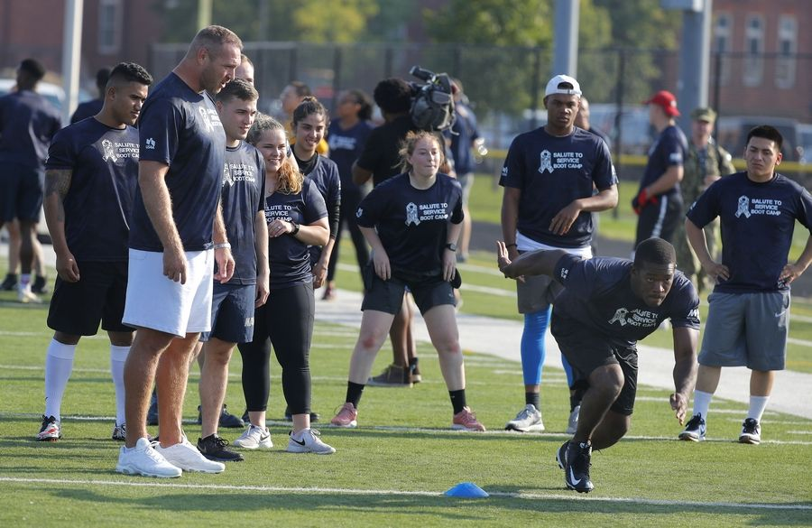 Brian Urlacher puts Great Lakes Naval Station military service members through drills during USAA's Salute to Service NFL Boot Camp Tuesday at Great Lakes Naval Station in North Chicago.