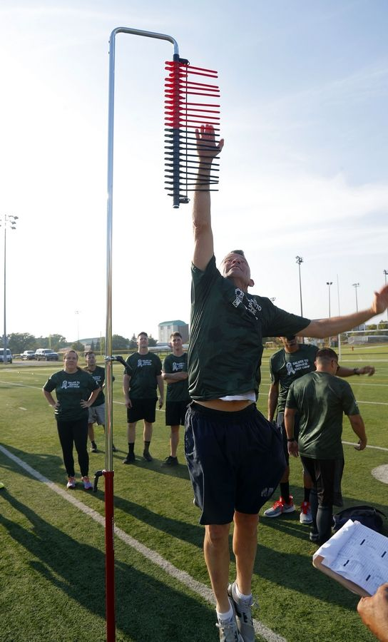 Chief Petty Officer Brian Brownlow competes in a jumping challenge as Great Lakes Naval Station military service members trained with NFL stars Brian Urlacher and Jordy Nelson in the USAA's Salute to Service NFL Boot Camp Tuesday at Great Lakes Naval Station in North Chicago.