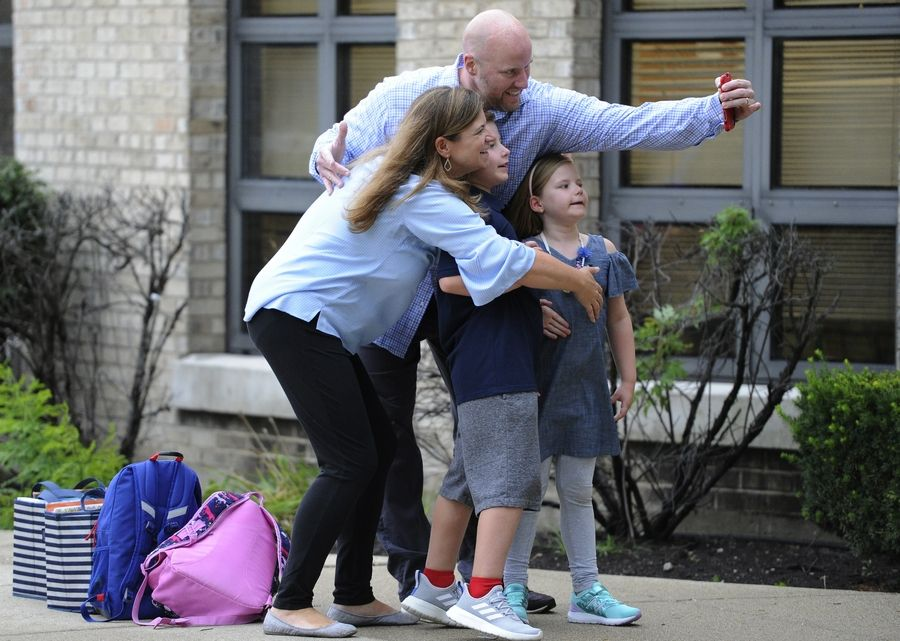 Peter and Becky Burns take a selfie with their children Max and Avery, both 6, on Tuesday before the kids head off to their first day of school at Riley Elementary School in Arlington Heights.
