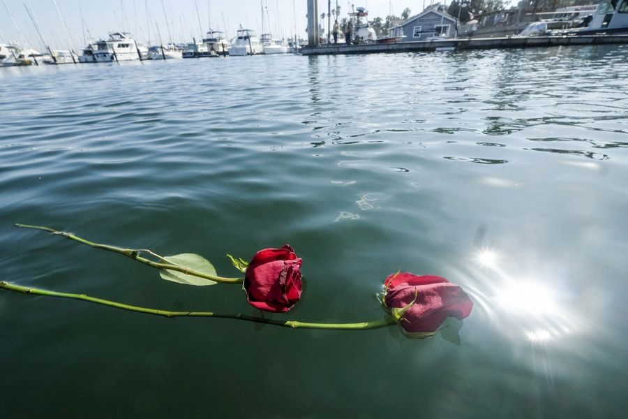 Flowers float on the water near the Sea Landing at Santa Barbara Harbor in Santa Barbara, Calif., Monday, Sept. 2, 2019. A fire raged through a boat carrying recreational scuba divers anchored near an island off the Southern California coast early Monday, leaving multiple people dead and hope diminishing that any of the more than two dozen people still missing would be found alive.