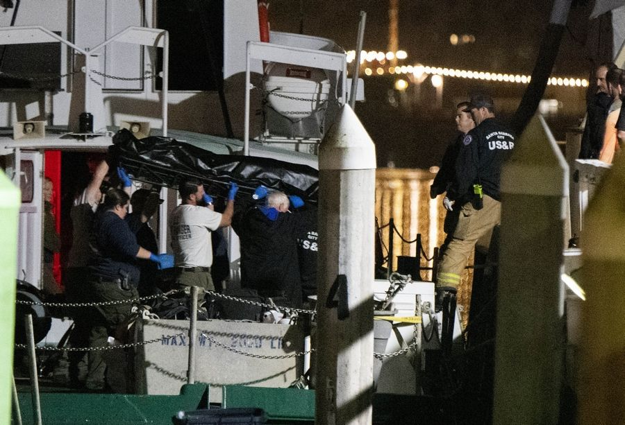 Local law enforcement along with search and rescue teams help unload the bodies of those who died in a diving boat fire, Monday, Sept. 2, 2019, in Santa Barbara, Calif. A fire raged through a boat carrying recreational scuba divers anchored near an island off the Southern California coast early Monday, leaving multiple people dead and hope diminishing that any of the remaining people still missing would be found alive.