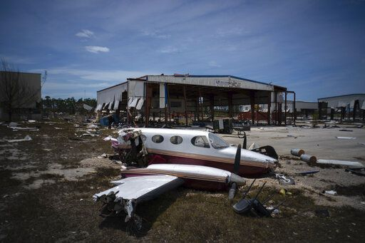 A plane destroyed by Hurricane Dorian sits amid debris at the airport in Freeport, Bahamas, Wednesday, Sept. 4, 2019. Rescuers trying to reach drenched and stunned victims in the Bahamas fanned out across a blasted landscape of smashed and flooded homes Wednesday, while disaster relief organizations rushed to bring in food and medicine.