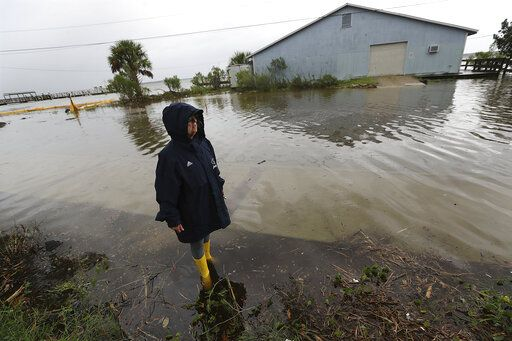September 4, 2019 St. Mary's: Cheryl Conners looks over flood waters surrounding Langs Marina near her home during Hurricane Dorian on Wednesday, Sept. 4, 2019,  in St. Mary's, Ga. (Curtis Compton/Atlanta Journal-Constitution via AP)