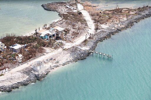 The destruction caused by Hurricane Dorian is seen from the air, in Marsh Harbor, Abaco Island, Bahamas, Wednesday, Sept. 4, 2019. The death toll from Hurricane Dorian has climbed to 20. Bahamian Health Minister Duane Sands released the figure Wednesday evening and warned that more fatalities were likely.