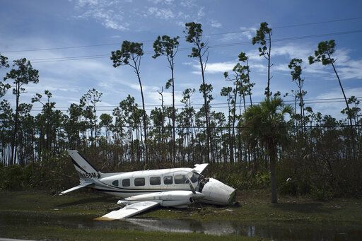 A broken plane lays on the side of a road in the Pine Bay neighborhood in the aftermath of Hurricane Dorian in Freeport, Bahamas, Wednesday, Sept. 4, 2019. Rescuers trying to reach drenched and stunned victims in the Bahamas fanned out across a blasted landscape of smashed and flooded homes Wednesday, while disaster relief organizations rushed to bring in food and medicine.
