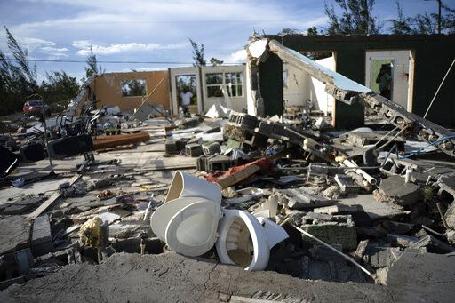 A toilet sits in the debris of George Bolter's home destroyed by Hurricane Dorian in the Pine Bay neighborhood of Freeport, Bahamas, Wednesday, Sept. 4, 2019. Rescuers trying to reach drenched and stunned victims in the Bahamas fanned out across a blasted landscape of smashed and flooded homes Wednesday, while disaster relief organizations rushed to bring in food and medicine.