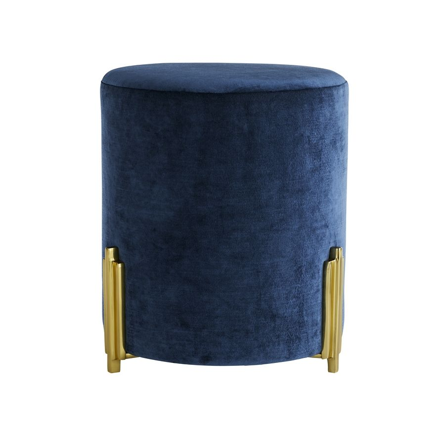 The Warby ottoman comes in a deep blue velvet with gold, art deco-inspired accents. It would add a chic touch of this inky hue to a living room, dressing room or master suite.