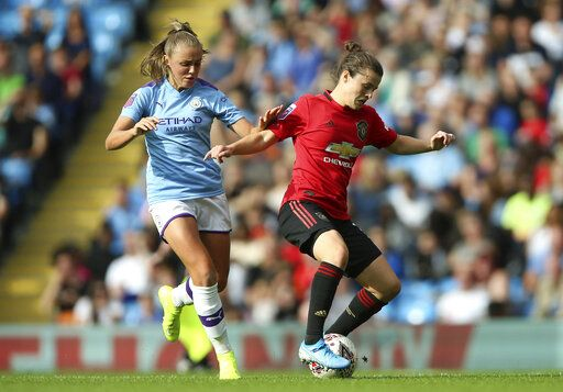 Manchester City's Georgia Stanway, left, and Manchester United's Hayley Ladd battle for the ball during the Women's Super League soccer match at the Etihad Stadium, Manchester, England, Saturday Sept. 7, 2019. (Nigel French/PA via AP)