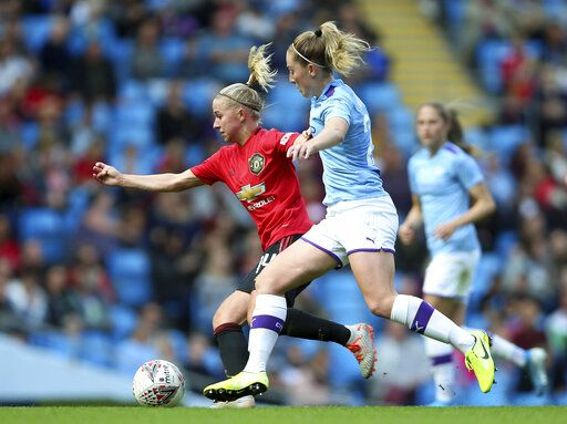Manchester City's Keira Walsh, right, and Manchester United's Jackie Groenen battle for the ball during the Women's Super League soccer match at the Etihad Stadium, Manchester, England, Saturday Sept. 7, 2019. (Nigel French/PA via AP)