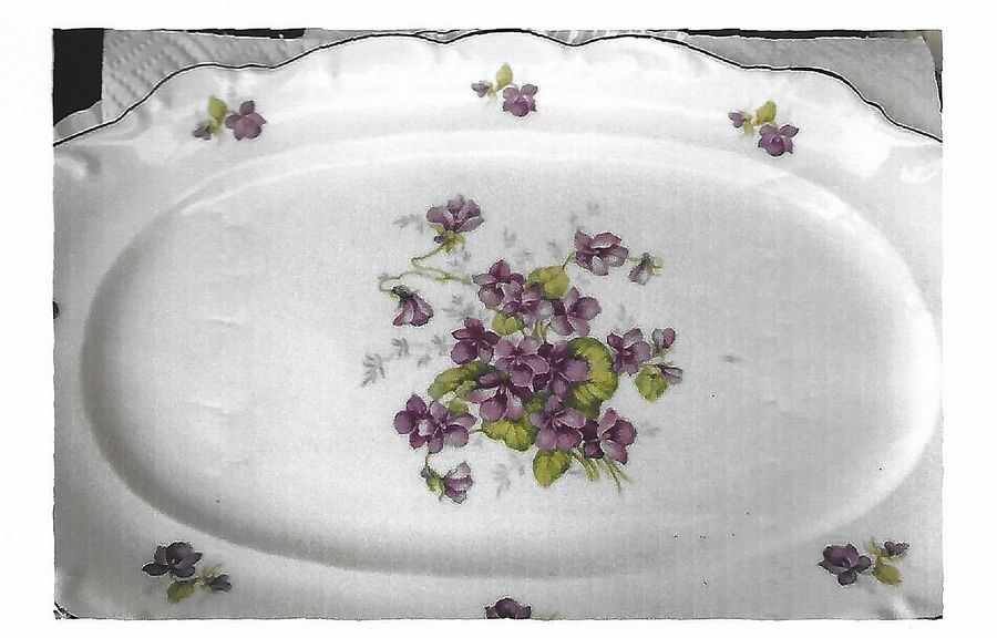 Porcelain dinnerware decorated with violets
