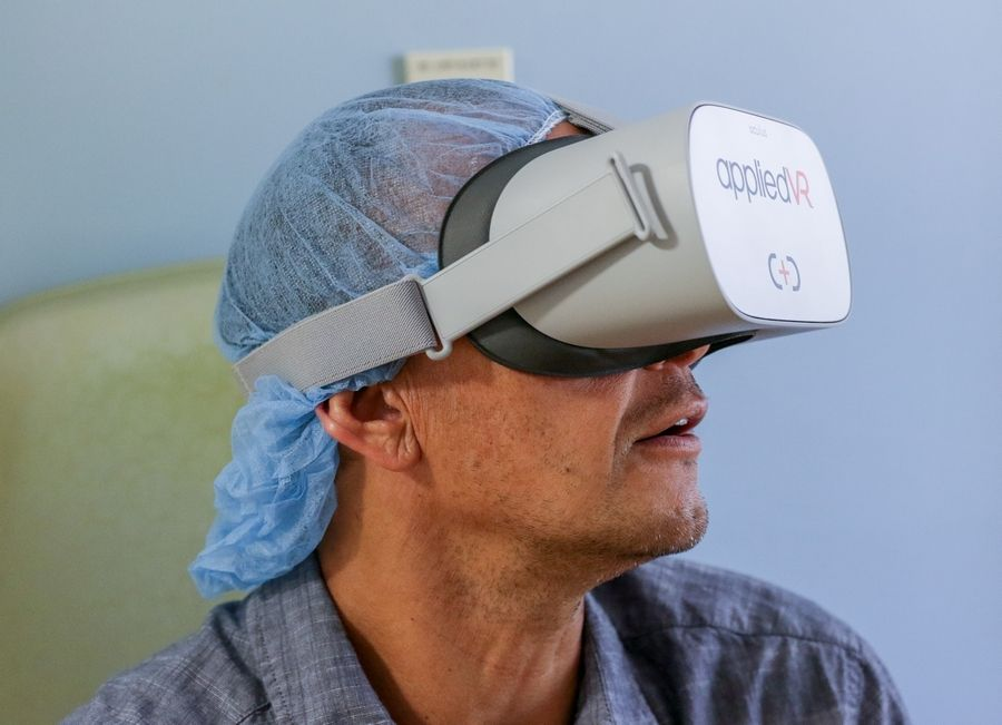 Chris Kudla of Romeoville takes a trip to the beach using virtual reality goggles to help in his fight with cancer. Edward Hospital in Naperville recently began using goggles to help pediatric and adult patients with pain management, as an alternative to opioid pain medications.
