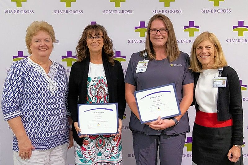 Cheryl Latsis, RN, second from left, and Kristin Bragg, RN, second from right, received a $1,000 scholarship to continue their education from Donna and Jim Galligan at a scholarship luncheon hosted by the Silver Cross Foundation at Silver Cross Hospital. Joining them are Donna Galligan, left, and Silver Cross President and CEO Ruth Colby..