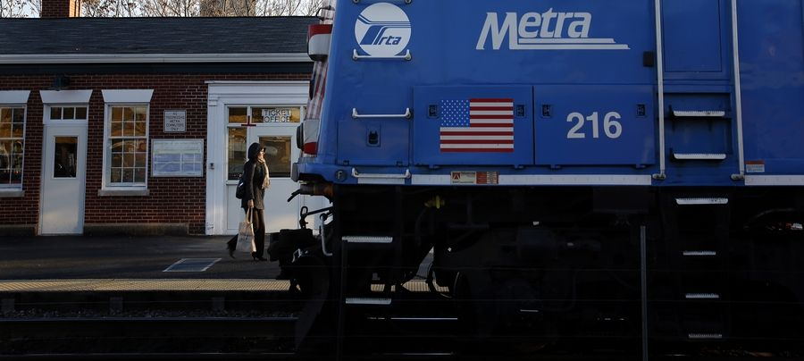 Commuters board a Metra train in Elgin. Commuters on Saturday will be bused over the Fox River while work is done on the first of two new bridges.