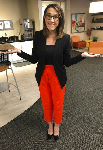 "This photo provided by Maggie Vespa, a weekend news anchor and TV reporter at NBC affiliate KGW-TV in Portland, Oregon, wearing one of five high-waisted pants that she wore for her five news casts over the weekend. Vespa wore the pants after a male viewer told her to ""dress like a normal woman� in a message sent to her Facebook work account. Vespa also delivered an on-air commentary about the remarks on Sunday's late-night news with the support of her managers. She wanted to draw attention to the pressure that women who work in the public eye face on a daily basis. (Maggie Vespa via AP)"