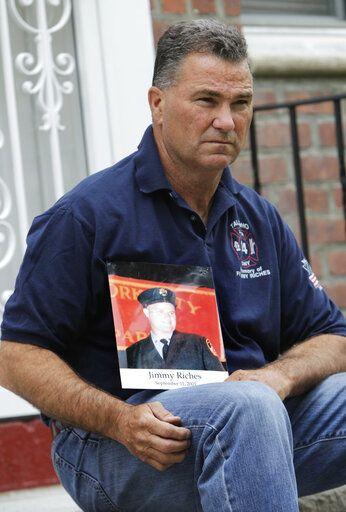 "FILE - In this May 3, 2012, file photo, Jim Riches, a retired New York deputy fire chief who responded to the 2001 terror attacks and lost his son, Jimmy, a fellow firefighter, poses for a photo with a photo of his son near his home in New York. Sept. 11 victims' relatives are greeting the news of President Donald Trump's now-canceled plan for secret talks with Afghanistan's Taliban insurgents with mixed feelings. ""I don't want to see other families suffer the way I did. That's the bottom line. Not soldiers or innocent victims of terrorism,� Riches said."