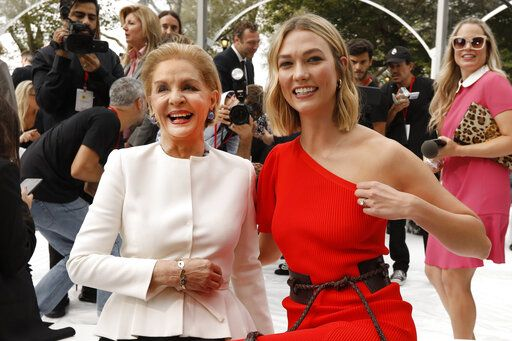 Carolina Herrera, left, poses with model Karlie Kloss before Herrera's namesake collection is modeled during Fashion Week, in New York, Monday, Sept. 9, 2019.