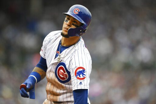 Chicago Cubs' Javier Baez reacts after being forced out at first base during the fifth inning of a baseball game against the Milwaukee Brewers, Sunday, Sept. 1, 2019, in Chicago.