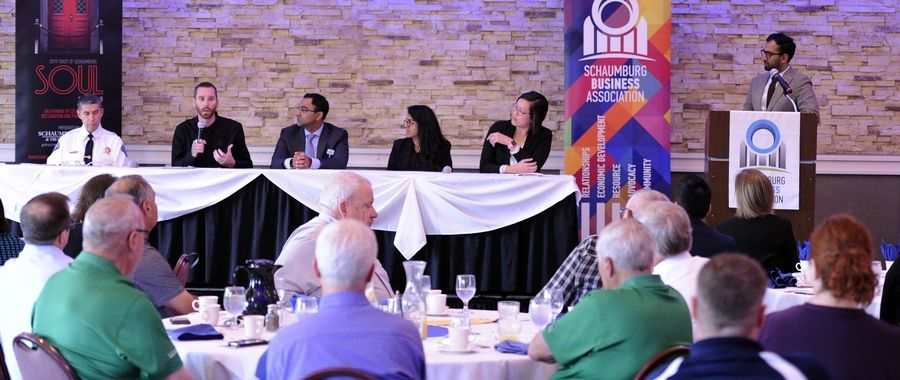 Brad Gerke, second from left with microphone, was among the experts to discuss the national opioid epidemic Tuesday during a panel discussion hosted by the Schaumburg Business Association.