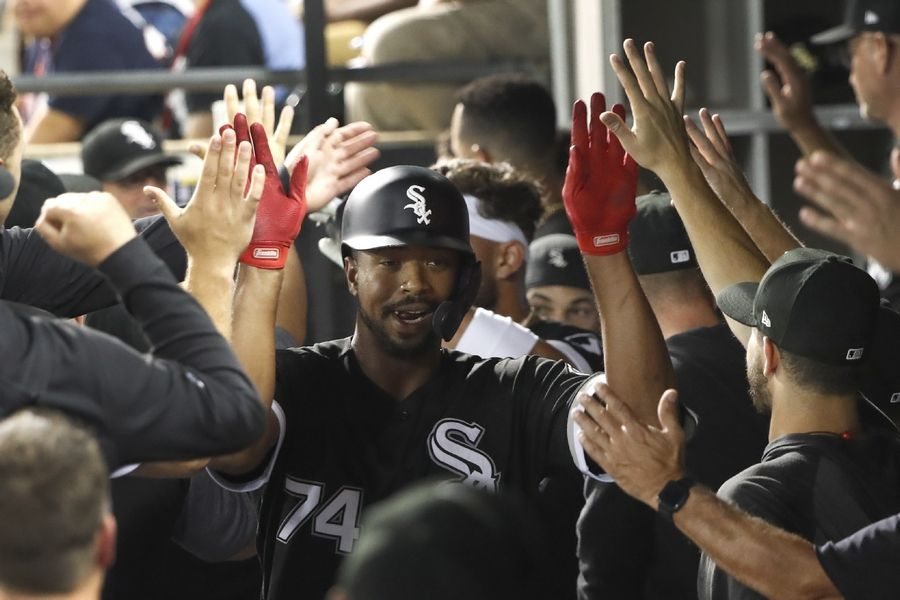 Chicago White Sox's Eloy Jimenez celebrates his grand slam in the dugout off Kansas City Royals starting pitcher Jakob Junis during the first inning of a baseball game Tuesday, Sept. 10, 2019, in Chicago.