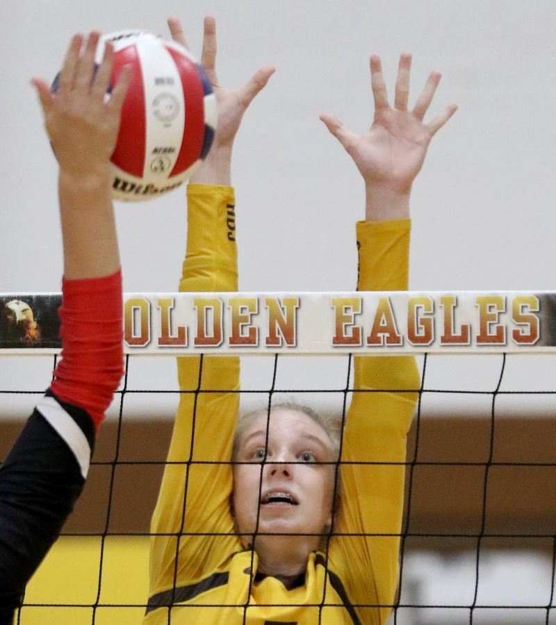 Jacobs' Rachel Kaczorowski blocks against Huntley in varsity girls volleyball Tuesday at Algonquin.