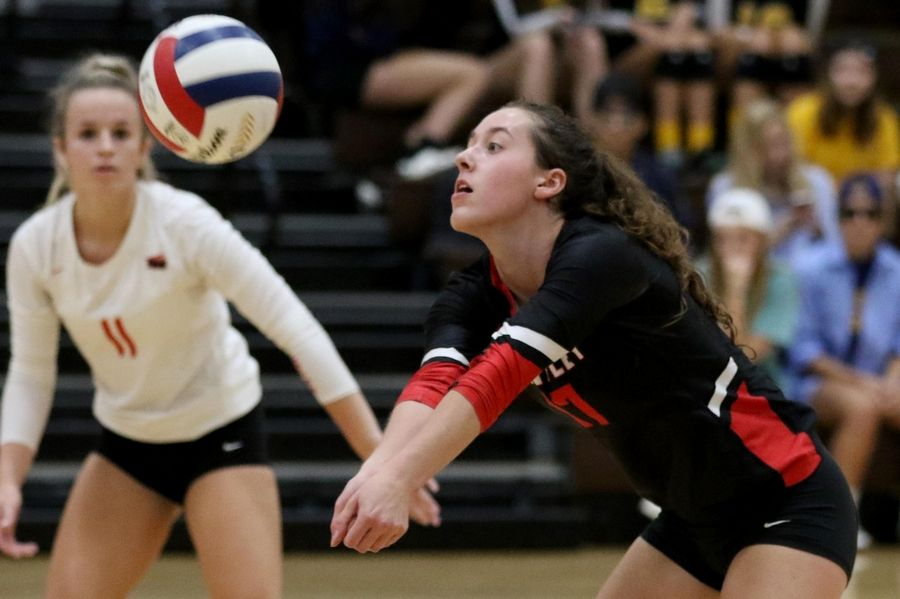 Huntley's Emma Konie, right, passes the ball as teammate Josie Schmitendorf keeps an eye on the ball against Jacobs in varsity girls volleyball Tuesday at Algonquin.