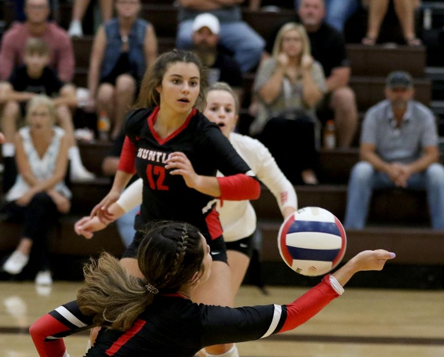 Huntley's Kylie Jenkins, front, passes as teammates Taylor Jakubowski, center, and Josie Schmitendorf, back, keep an eye on the ball against Jacobs Tuesday at Algonquin.