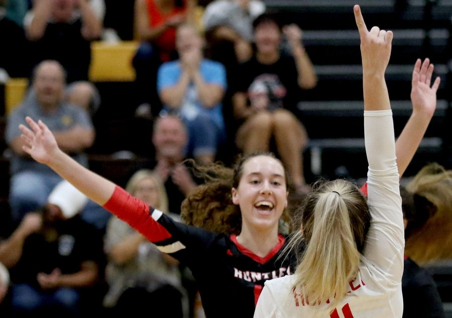 Huntley's Josie Schmitendorf, front, celebrates with teammate Emma Konie against Jacobs in varsity girls volleyball Tuesday at Algonquin.
