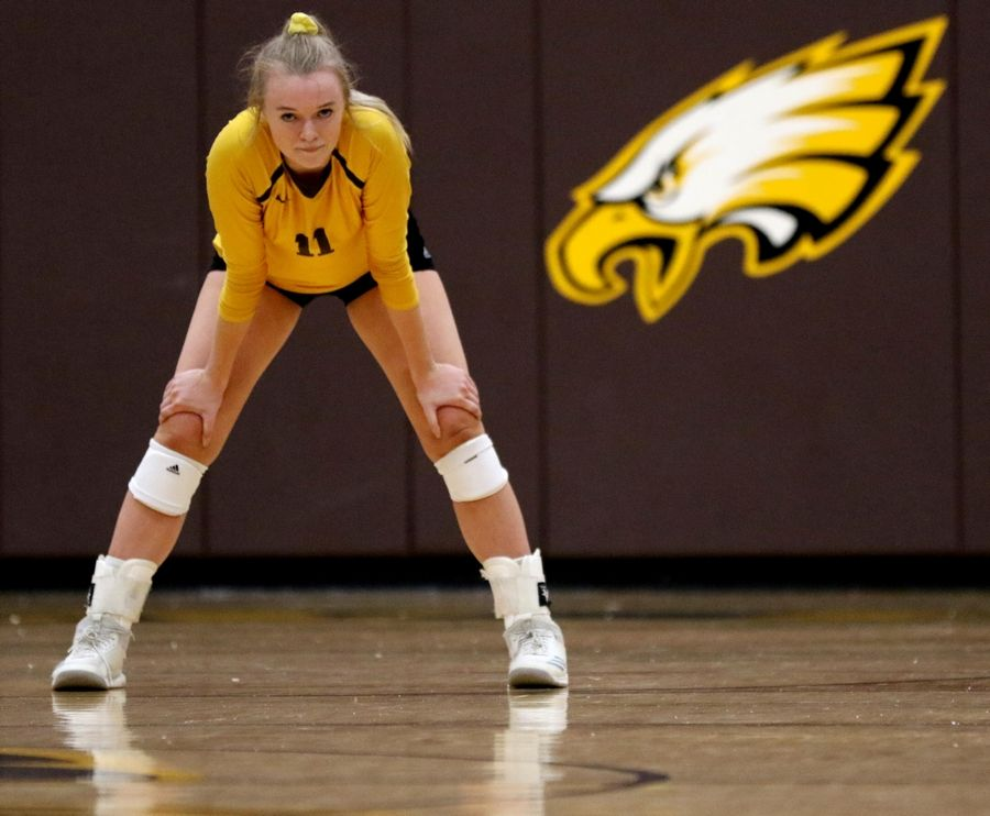 Jacobs' Maggie Wallenberger prepares to play Huntley in varsity girls volleyball Tuesday at Algonquin.