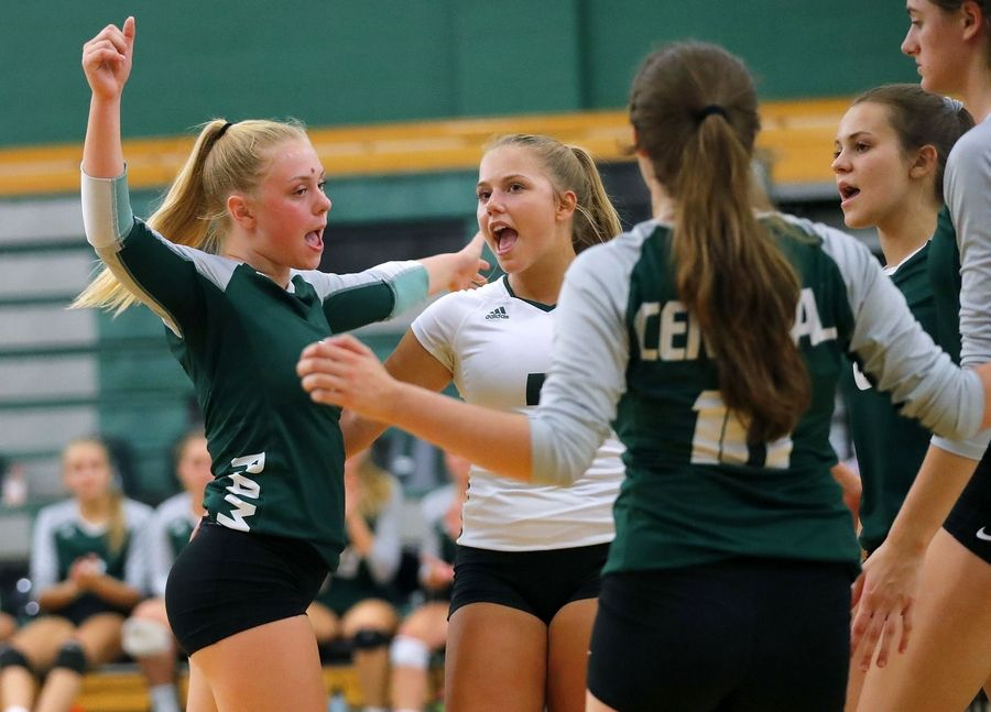Grayslake Central players celebrate after winning a point during their match against Waukegan Tuesday at Grayslake Central High School.