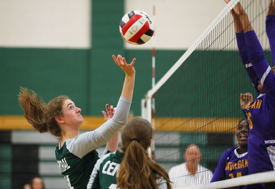 Grayslake Central's Kate Bullman tips the ball during the Rams' match against Waukegan Tuesday at Grayslake Central High School.